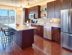 Hardwood-style flooring or concrete floors available