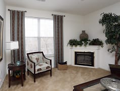Spacious Living Room with Fireplace - Riverchase Apartments