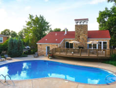 Outdoor swimming pool with lounge chairs