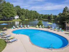 Resort-style swimming pool and pool deck area overlooking the community's 5 acre fishing pond.