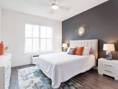 Large bedrooms with oversized windows, window treatments, ceiling fans, and walk-in closets