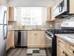 Townhome Kitchen with Stainless Steel Appliances and Hard Surface Vinyl Plank Flooring