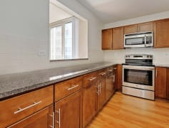 Enjoy a newly-renovated kitchen with granite countertops and stainless steel appliances