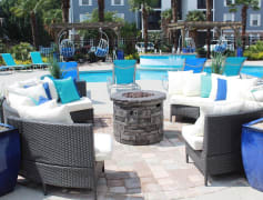 Relax on our expansive sundeck by the poolside fire pit.