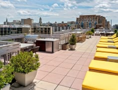 Rooftop sundeck with Wi-Fi access and lounge chairs