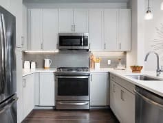 Modern Kitchens with Quartz Countertops, Glass Tile Backsplash, and Hard Surface Flooring