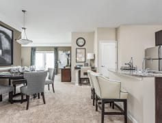 Open Kitchen with Breakfast Bar and Living Room - Aston