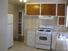 Kitchen with gas range and fridge.