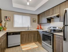 Sleek stainless steel appliances and warm wood-tone cabinets give your kitchen a modern feel