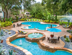 Beautiful, lush landscaping and fountains surrounds the pool area.