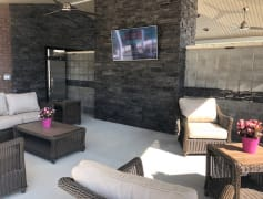 Outdoor seating area with television AND Refrigerator!