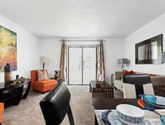 Spacious Living Room View with Patio or Balcony Glass Door - Invitational