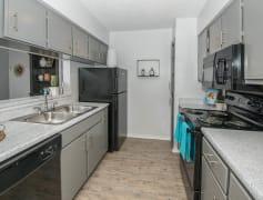 Modern grey cabinets with sleek black appliances