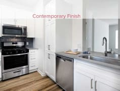 Coming Soon - Newly Renovated Apartments with Kitchens Featuring Quartz Countertops, Stainless Steel Appliances, Tile Backsplashes, and Hard Surface Vinyl Plank Flooring (Representative Photo)