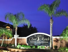 Landings at Boot Ranch Apartments Sign at Night