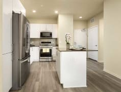 Newly renovated kitchens feature quartz countertops, new cabinetry, stainless steel appliances, and hard surface plank flooring (Representative photo)
