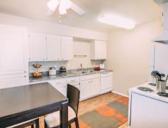 White cabinet kitchen with white appliances