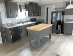Modern & convenient kitchen w/ an island & matching appliances