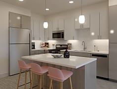 Polished quartz countertops and mosaic tile backsplash are sure to inspire your inner chef