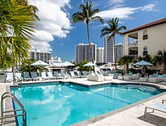 Outdoor, saltwater pool and sundeck overlooks the marina and views of the city