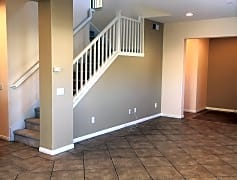 Bigem 2 living room and stairs looking toward entry.JPG