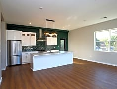 Huge 10 ft eat in island, custom cabinets & light fixtures, Jenn Air chefs appliances, quartz countertops
