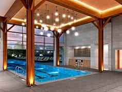 25-meter heated indoor / outdoor saltwater swimming pool with retractable glass wall