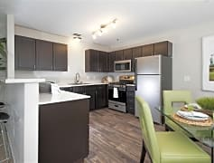 Freshly updated kitchens feature silver and black appliances and chocolate cabinetry