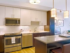 Brand-new kitchens feature stainless steel appliances, two-tone modern cabinets and quartz countertops