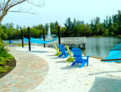 Relax and soak in the sun from our beach area, including hammocks.