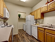 An open kitchen with lots of cabinet storage and easy access to the laundry room