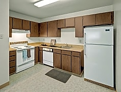 A kitchen with white appliances and cabinet storage
