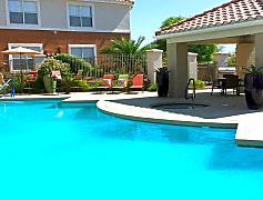 Sparkling swimming pool featuring an expansive sundeck.
