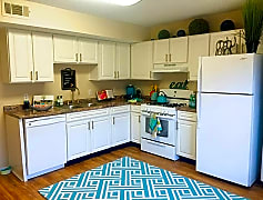 Your newly remodeled, spacious kitchen features wood-style flooring and an ample amount of cabinet space.