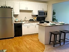 Newly renovated kitchens featuring wood-style flooring, breakfast bars and stainless steel appliances.