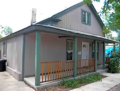Front covered porch next to off street parking