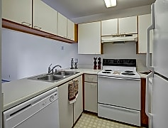 A kitchen with white appliances and cabinetry