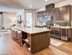 Beautiful Luxury Kitchen, with Granite kitchen counter tops, gormet kitchen island, tile kitchen backsplash. Built in wine chiller. Contemporary kitchen faucet with retractable wand sprayer