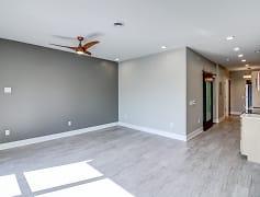 Open floor plan and neutral color scheme.