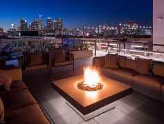 Enjoy an evening by the fire on the rooftop deck