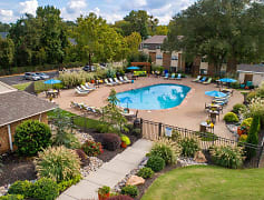 Sparkling resort-style pool with plenty of loungers and seating.