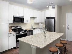 Kitchens with quartz or granite countertops, stainless steel appliances, and hard surface plank flooring (Representative Photo)