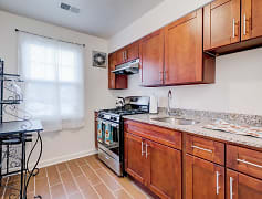 Renovated kitchen with stainless steel appliances and granite counter tops