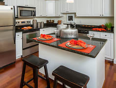 Steel Appliances, White Cabinetry, Island Kitchens, Dark Granite Counters and Breakfast Bars at Halstead Abington