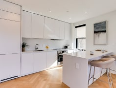 Newly renovated kitchen with Quartz countertops and an integrated fridge and dishwasher