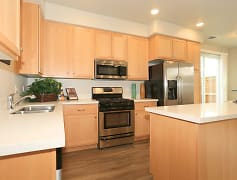 Spacious modern kitchen with island in our 2, 3 & 4 bedroom townhomes
