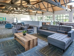 Resident Lounge with large windows and exposed beams.