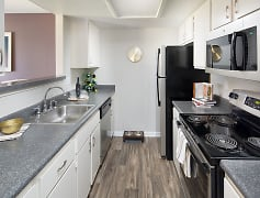 Newly renovated kitchens feature brand new silver appliances and granite inspired countertops