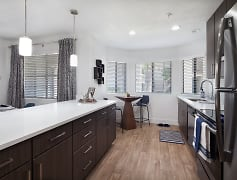 Modern kitchen featuring quartz counter tops, stainless steel appliances, and brushed nickel finishes.