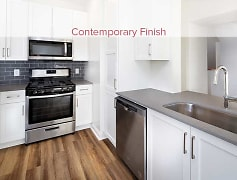 Newly renovated kitchen with quartz countertops, tile backsplash, and stainless appliances (in select homes)